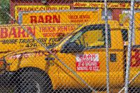 Trucks and Chain Link Fence, Astoria, New York City, 2010