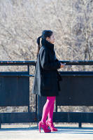 Woman with Magenta Tights and Shoes, 225th Street, New York City, 2010